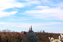 Georgetown University under blue sky in spring. Georgetown University photographed from Rosslyn suburb of Washington DC, USA Stock Photo
