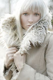 Georgeus woman!. Portrait of a beautiful girl wearing white fur royalty free stock image