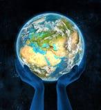 Georgië op aarde in handen Royalty-vrije Stock Afbeelding