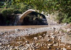 Georgia, an ancient stone bridge, from the times of Tamar`s tsar Stock Photography