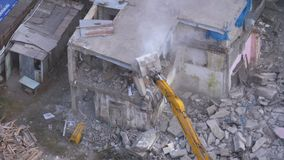 Destroying Old House Using Bucket Excavator on Construction Site.