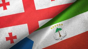 Georgia and Equatorial Guinea two flags textile cloth, fabric texture. Georgia and Equatorial Guinea two folded flags together royalty free illustration