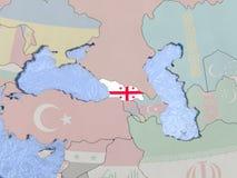 Georgia with flag on globe Stock Photos