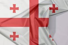Georgia-Gewebeflaggenkrepp und -falte mit Leerraum lizenzfreies stockbild