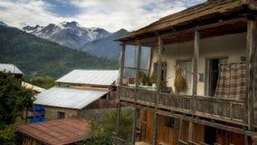 Georgia,Gruzia,country house in Svaneti. Georgia,Gruzia,Svaneti region ,village house and mountains on the horizon stock photo