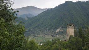 Georgia,Gruzia,Mestia,the watchtowers. Georgia,Gruzia,Svaneti region ,Mestia,the ancient watchtower against the mountains royalty free stock image