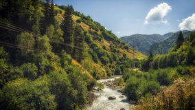 Georgia,Gruzia,near Ushguli,river in the valley. Georgia,Gruzia,Svaneti region ,river flows near the road ,hills and valley royalty free stock photography