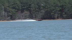 Georgia, Lake Alatoona, Two boats cross each other, following one, then the other. Two speedboat cross each other on Lake Alatoona, right to left, then left to stock footage