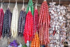 Georgia, local market. Sale of national sweets from grapes and nuts - `Churchkhela`, dried fruit. stock photography