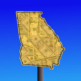 Georgia map with cash. Warning sign in shape of Georgia with American dollars Stock Photography