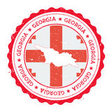 Georgia map and flag in vintage rubber stamp of. Royalty Free Stock Photos