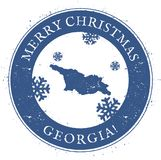 Georgia map. Vintage Merry Christmas Georgia. Georgia map. Vintage Merry Christmas Georgia Stamp. Stylised rubber stamp with county map and Merry Christmas text Royalty Free Stock Photo