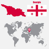 Georgia map on a world map with flag and map pointer. Vector illustration Stock Photos