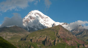 Georgia - Mount Kazbek. Mount Kazbek ( 5,047 m  or 16,558 ft) is one of the major mountains of the Caucasus located in the Kazbegi District of Georgia and North Stock Photo