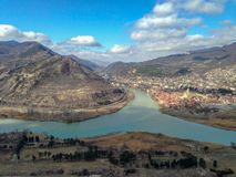 Georgia, Mtskheta: river confluence and mountains top view. Confluence of Aragvi and Kura rivers. Beautiful georgian landscape. stock photos