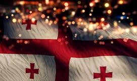 Georgia National Flag Light Night Bokeh abstrakt begreppbakgrund Royaltyfria Foton