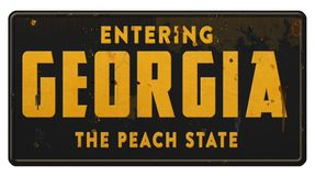 Georgia State Sign Highway Freeway Road Grunge The Peach State. Vintage Georgia Street Sign Entering state of metal road highway tin grunge retro black and royalty free stock photos