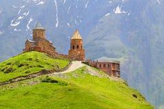 Georgia.Stepantsminda-Sameba. Ancient Gergeti Trinity Church high in the mountains.Caucasus. Royalty Free Stock Image