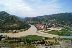 Georgia symbol - ancient capital. View to confluence Aragvi and Mtikvari rivers and town of Mtsheta from Jvari church. Georgia Stock Photos