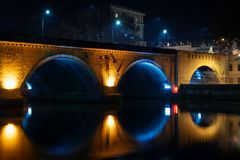 Georgia, Tbilisi - 05.02.2019. - Famous Dry bridge over river Mtkvari illuminated with colorful lights in the night stock images