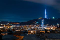 Georgia, Tbilisi - 05.02.2019. - Night cityscape view. Beautiful tv tower and famous landmarks illuminated - Image stock photography