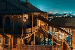 Georgia, Tbilisi - 05.02.2019. - Night time in Tbilisi old town district. Old wooden architecture - Night image royalty free stock photo