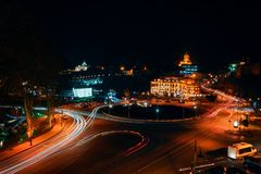 Georgia, Tbilisi - 05.02.2019. - Night view over Europe square and Holy trinity Sameba church in the Background royalty free stock image