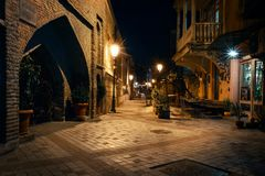Georgia, Tbilisi - 05.02.2019. - Night view from the streets of Tbilisi old town. Ancient architecture and street lights stock photography