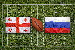 Georgia vs. Russia flags on rugby field Royalty Free Stock Photos