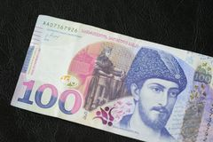 Georgian banknote in one hundred lari on a dark background. Close up royalty free stock photo