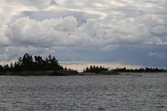 Georgian bay coastline with intense clouds. Georgian bay coastline incredible clouds hanging over the coast Royalty Free Stock Image