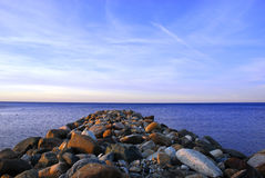 Georgian Bay Rocks. Georgian Bay break wall, Early april sunset stock image