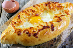 Georgian cheese pie and yolk closeup. Royalty Free Stock Photography