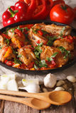 Georgian cuisine: chicken stew with vegetables close-up. vertica Stock Image
