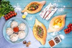 Georgian cuisine foodset from khachapuri, khinkali, top view. royalty free stock photos