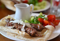 Georgian cuisine - Kebab in pita bread. Royalty Free Stock Images