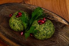 Georgian cuisine - Phali. With spinach and beans royalty free stock images