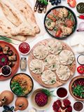 Georgian cuisine on white table top view stock photography