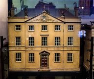 Georgian Doll`s House. For Children at V&A Museum of Childhood London. May Foster`s House in a Display Cabinet royalty free stock image