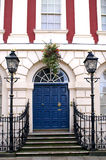 Georgian Door. Grand and elegant Georgian blue door with georian street lights steps and fainted facade to building showing great period features to this double Royalty Free Stock Image
