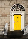 Georgian door in Dublin. Yellow Georgian door in Dublin Stock Photo