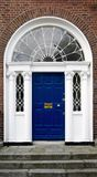 Georgian doorway. In Dublin, Ireland, with cast iron fanlight and ionic columns Stock Photography