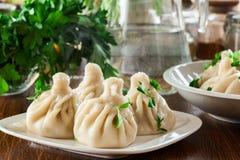 Georgian dumplings - Khinkali Chinkali with minced meat and herbs stock photo