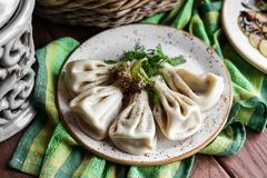 Georgian dumplings Khinkali with meat, greens on a wooden rustic table stock images