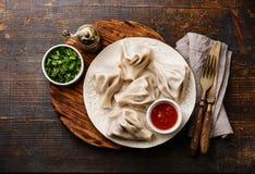 Georgian dumplings Khinkali and tomato sauce Royalty Free Stock Images