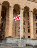 Georgian flag on the background of the building. Of the Georgian Parliament Royalty Free Stock Photos