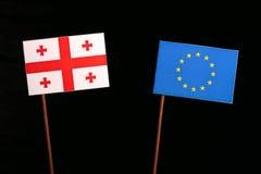 Georgian flag with European Union EU flag isolated on black. Background Stock Images