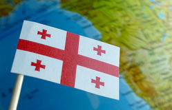 Georgian flag with a globe map as a background Royalty Free Stock Photo