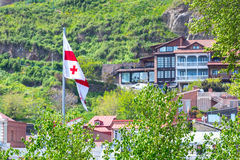 Georgian flag and Old Town of Tbilisi, Republic of Georgia Royalty Free Stock Images