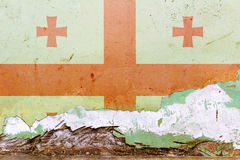 Georgian flag painted on a concrete wall. Flag of Georgia. Textured abstract background Stock Images
